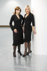 petite Affair - The dark haired model wears the Annette Black Dress sizes XS - XL £75, and the blonde model wears the Classic Wrap Black Dress sizes 6-16 at £49.